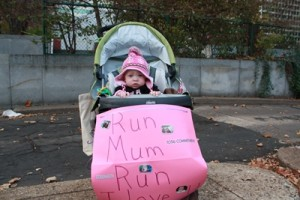 Preemie in stroller with sign that says Run Mum Run